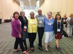 Six of the 2002 Newbery Committee members got together and took a photo (JoAnn Jonas, Elizabeth Overmeyer, Deborah Taylor, Vaunda Nelson, Patty Carlton, Roxanne Feldman)